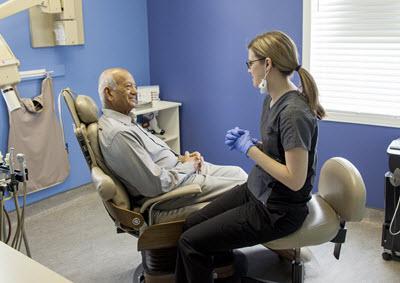 discussing teeth whitening procedure